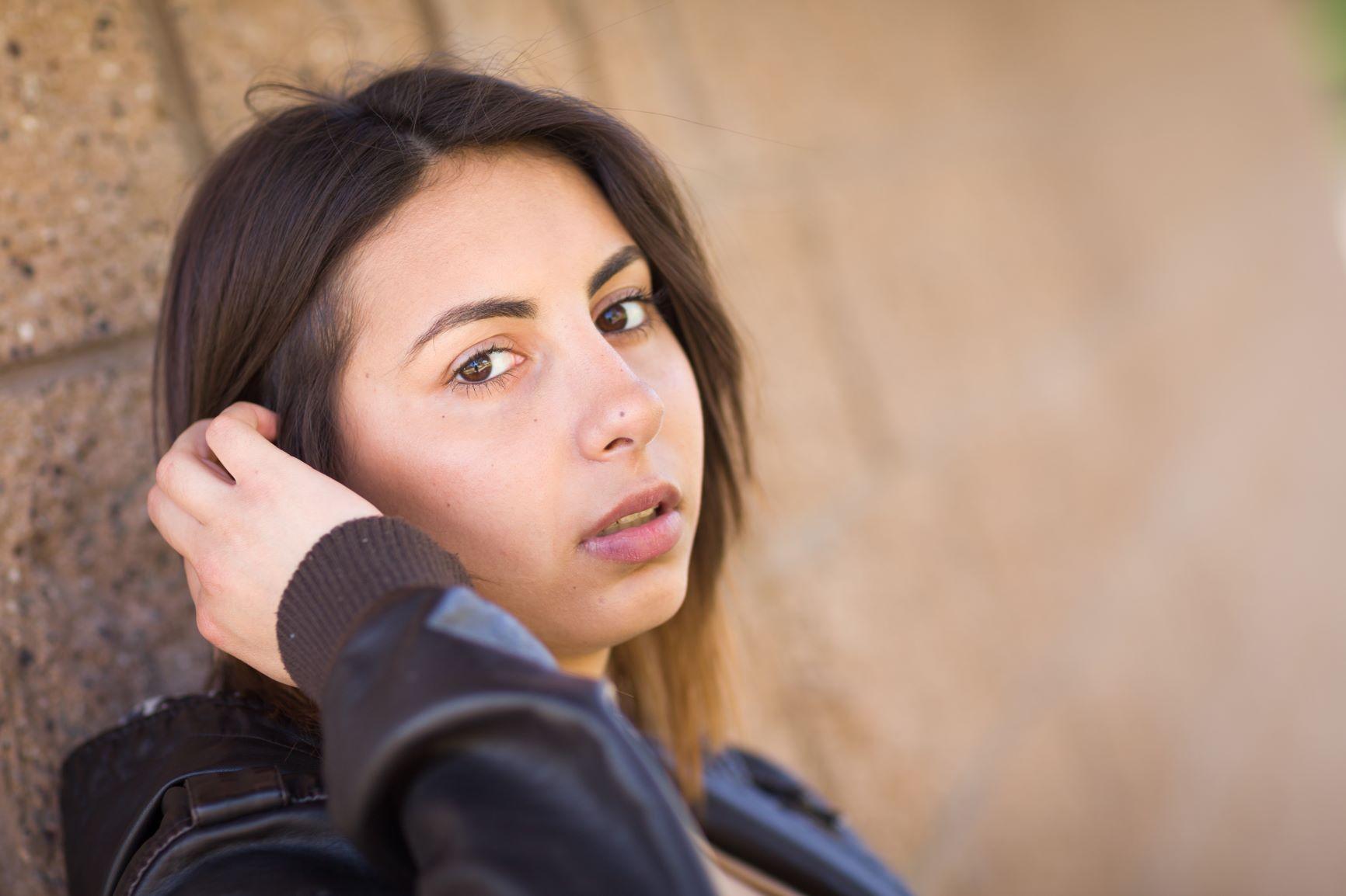 594 23338212 beautiful meloncholy mixed race young woman portrait light