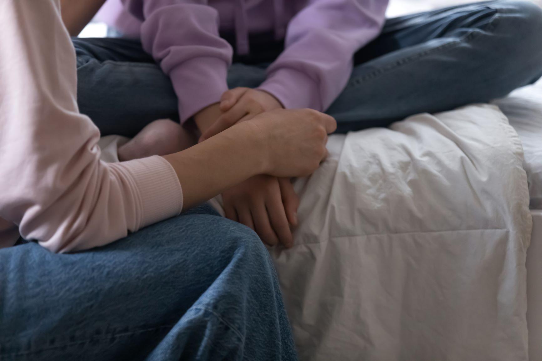 596 42748798 close up of loving mom support sad teenage daughter