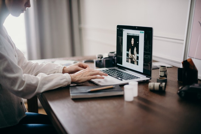 13542 selective focus photography of woman using macbook pro 3584996
